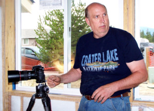 Mike Jensen, President/CEO of JensenOne Marketing & Photography works to record Kelly Butler's video.